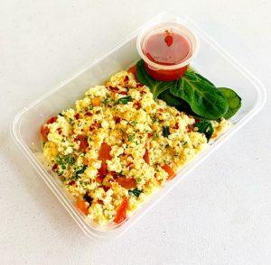 Mozzarella eggs with tomato salsa in meal prep tray