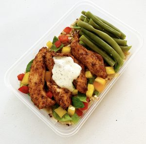 Cajun Chicken With Mint Sauce in meal prep tray